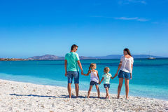 Young beautiful family with two kids on tropical Stock Photography