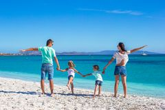 Young beautiful family with two kids on tropical Royalty Free Stock Image