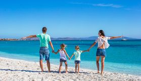Young beautiful family with two kids on tropical Royalty Free Stock Photo
