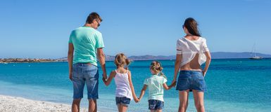 Young beautiful family with two kids on tropical Stock Images