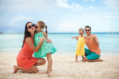 Young beautiful family with two kids on tropical Royalty Free Stock Photos
