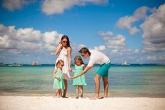 Young beautiful family with two kids walking at Royalty Free Stock Photo