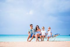 Young beautiful family on white beach Royalty Free Stock Images