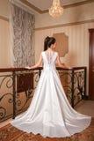 Young beautiful fashion bride posing in studio, view back. Young beautiful fashion bride posing in studio Stock Images