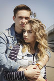 Young beautiful fashion couple wearing jeans clothes in daylight Stock Photo