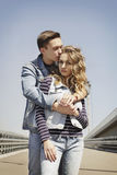 Young beautiful fashion couple wearing jeans clothes in daylight Stock Photography