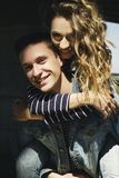Young beautiful fashion couple wearing jeans clothes in daylight Stock Images