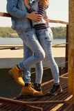 Young beautiful fashion couple wearing jeans clothes in daylight Royalty Free Stock Photo