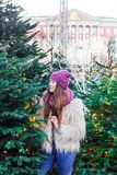 Young beautiful fashion girl is enjoying her time through winter holiday in Christmas evening, Moscow, Tverskaya Square stock image