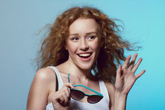 Young beautiful fashion girl smiling with his hand raised and su Stock Photography