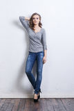 Young and beautiful fashion model in jeans Royalty Free Stock Images