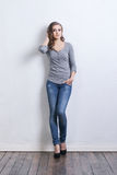 Young and beautiful fashion model in jeans Royalty Free Stock Photo
