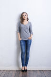 Young and beautiful fashion model in jeans Stock Photo