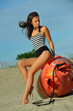 Young beautiful fashion model in onepiece stripped swimsuit Stock Photo