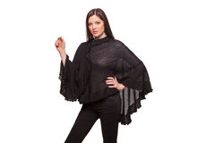 Young beautiful fashion model with poncho posing. studio shot, isolated on white background. Royalty Free Stock Photography