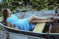 Young beautiful fashion model posing on boat Royalty Free Stock Photos