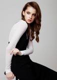 Young beautiful fashion model wearing black dress Royalty Free Stock Photos