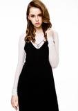 Young beautiful fashion model wearing black dress Royalty Free Stock Image