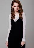 Young beautiful fashion model wearing black dress Stock Photos