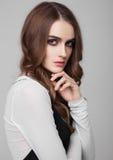 Young beautiful fashion model wearing black dress Stock Images