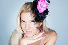 Young beautiful fashion woman posing in studio Stock Photography