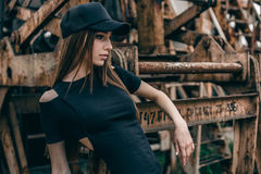 Young beautiful fashionable brunette woman in black dress stock photography