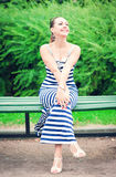 Young beautiful fashionable woman wearing striped dress Royalty Free Stock Photos