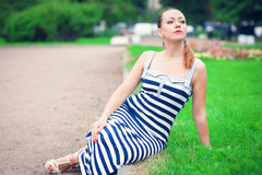 Young beautiful fashionable woman wearing striped dress Royalty Free Stock Images