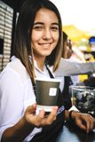 Young and beautiful female barista posing a smile Royalty Free Stock Photos