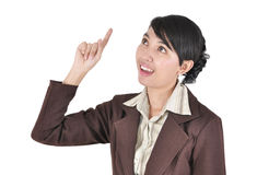Young beautiful female business executive pointing Royalty Free Stock Image