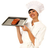 Young beautiful female chef presenting meat Royalty Free Stock Image