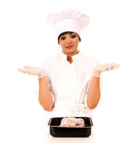 Young beautiful female chef presenting raw chicken Stock Photography