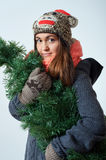 Young beautiful female with a christmas tree. Young beautiful female carrying a christmas tree Stock Image