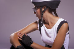 Young and beautiful female cyclist  wearing professional gear. i Royalty Free Stock Photo