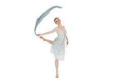 Young beautiful female dancer with blue scarf. Full length of a young beautiful female dancer with blue scarf against white background royalty free stock photos