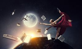 Young and beautiful female dancer in a red dress. Dancing in space stock photography