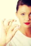 Young beautiful female doctor holding pink pill Royalty Free Stock Image