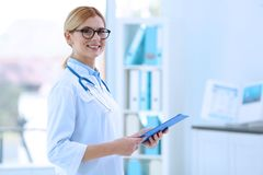 Young beautiful female doctor. Indoors Stock Image