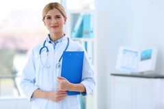 Young beautiful female doctor. Indoors Stock Photo