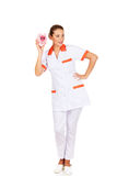 Young beautiful female doctor or nurse holding a piggybank Stock Images