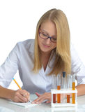 Young beautiful female doctor with recipe Stock Image