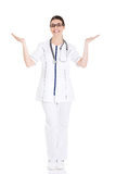 Young beautiful female doctor showing on copy space. Royalty Free Stock Photography