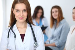 Young beautiful female doctor smiling while consulting her patient. Physician at work. Medicine and healthcare concept royalty free stock image