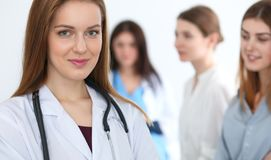Young beautiful female doctor smiling while consulting her patient. Physician at work. Medicine and healthcare concept stock photos