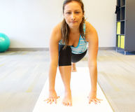 Young beautiful female doing yoga Royalty Free Stock Images