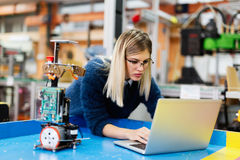 Young beautiful female engineer testing and programming Royalty Free Stock Images
