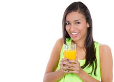 young beautiful female holding a glass of orange juice Stock Images