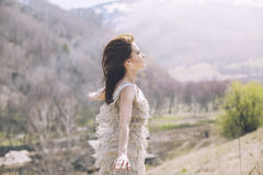 Young beautiful female model in a landscape with mountains and v stock photos