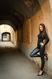 Young beautiful female model standing near wall Stock Photo