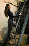 Young beautiful female model standing near wall Stock Photography